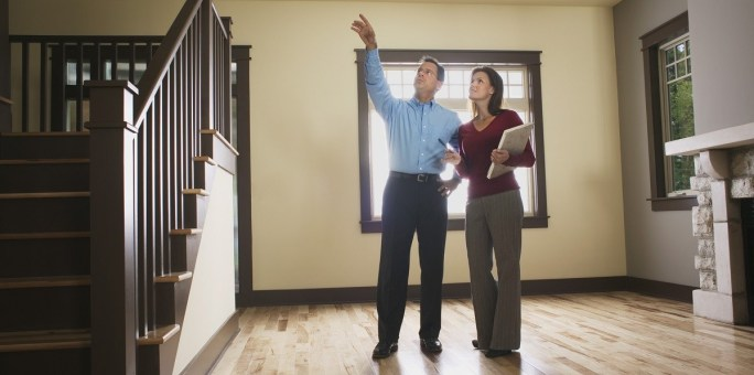 Man and woman inspecting empty house